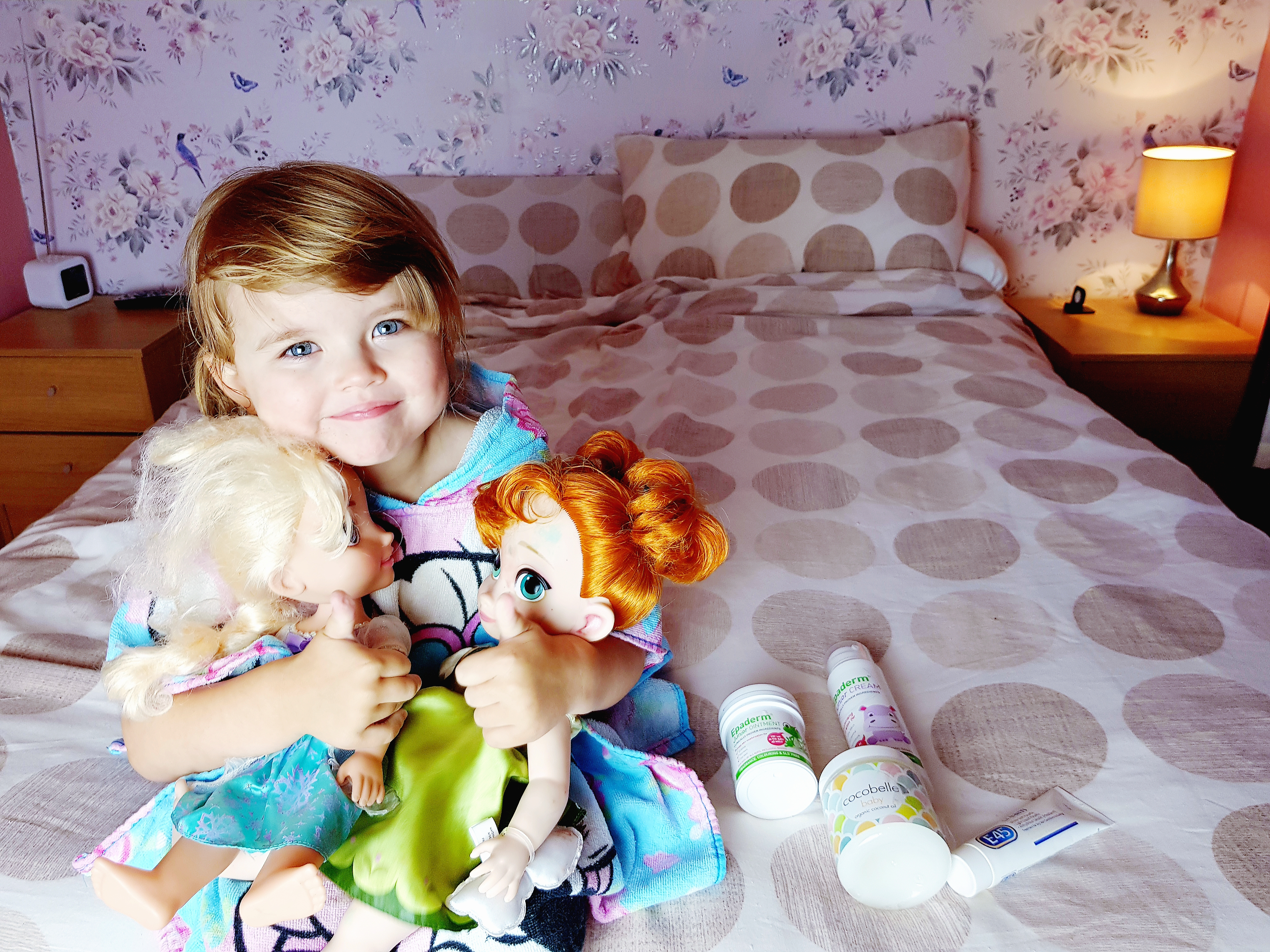 Shaniah with her skin care products and dolls